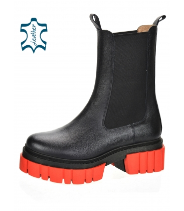 Black low boots with elastic material on a high red sole 8135